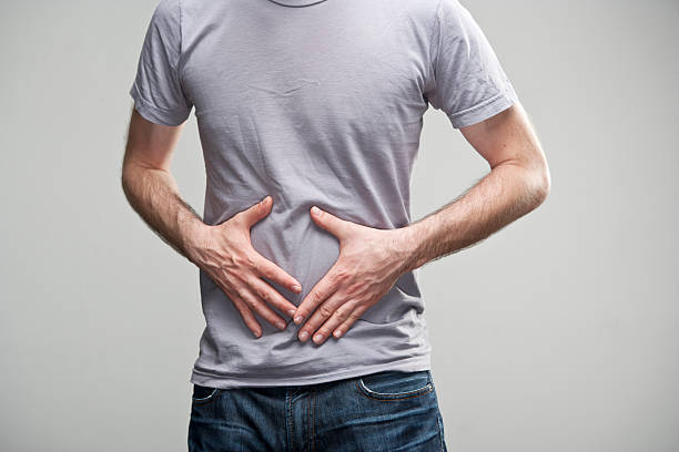 stomach ache - human digestive system stock pictures, royalty-free photos & images