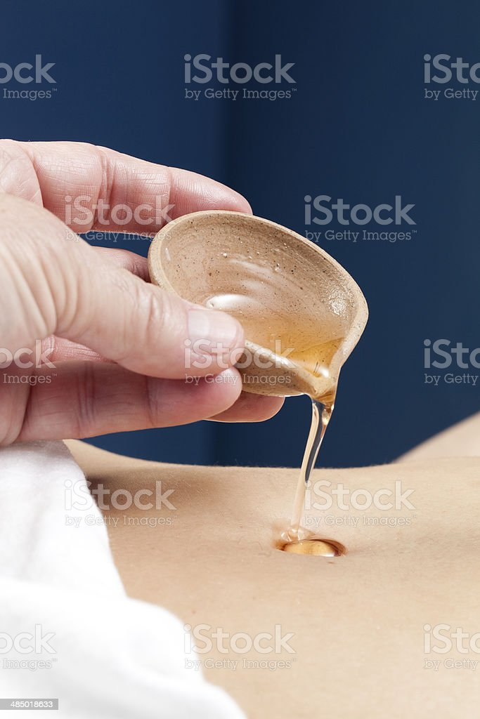 stomach and liver Indian therapy with ghee - Royalty-free Abdomen Stock Photo
