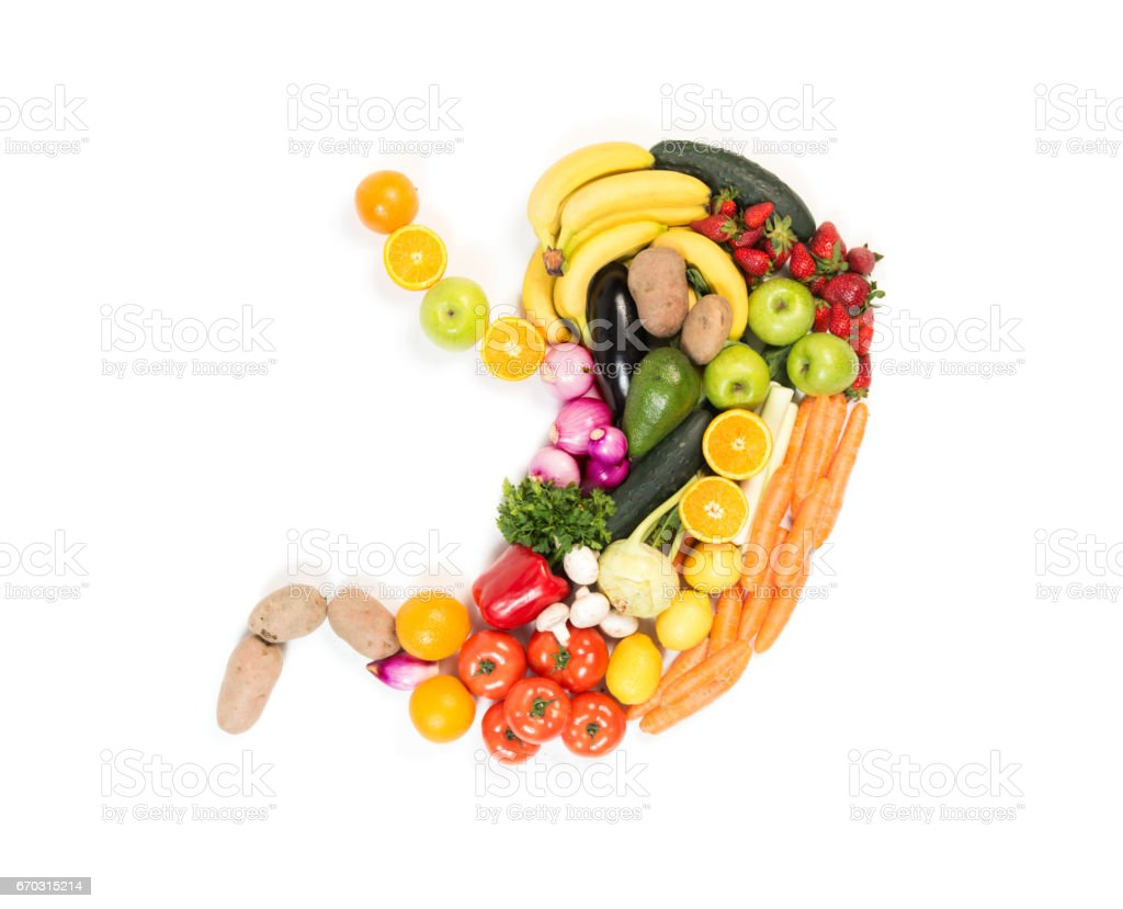 Stomach made out of fruits and vegetables isolated on white background stock photo