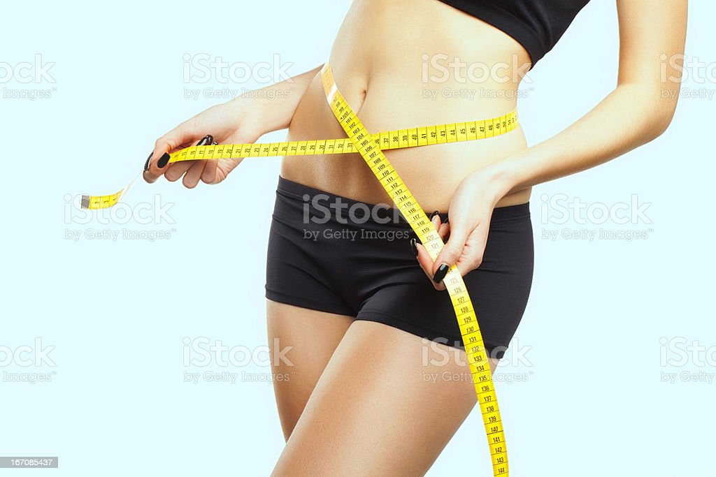 Stomach Of Beautiful, Fit, Young Woman Measuring Her Waist stock photo