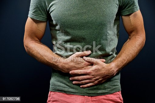 istock Stomach pain both hands 917052736