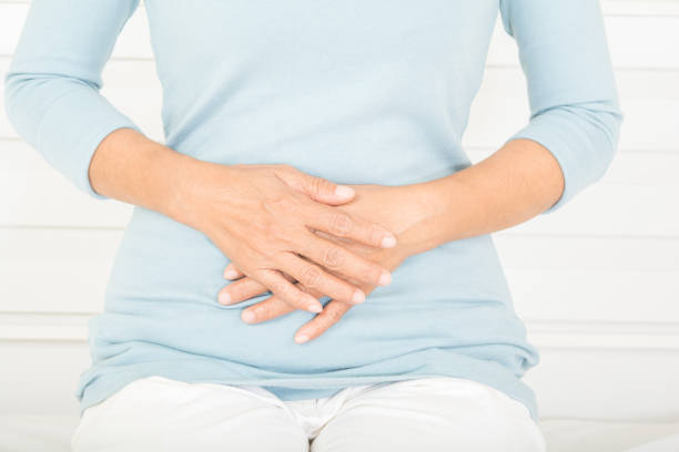 stomachache in old women stock photo