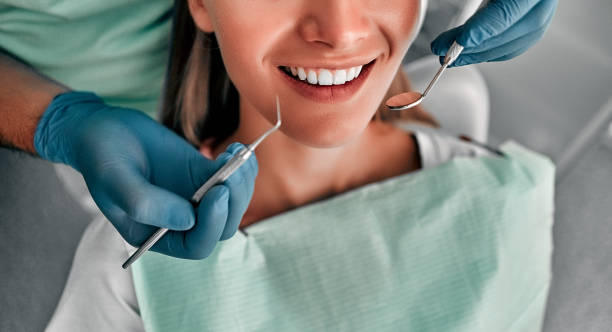 Stomatology Cropped shot of dentist examining teeth of beautiful female client. Healthy teeth concept. dental health stock pictures, royalty-free photos & images