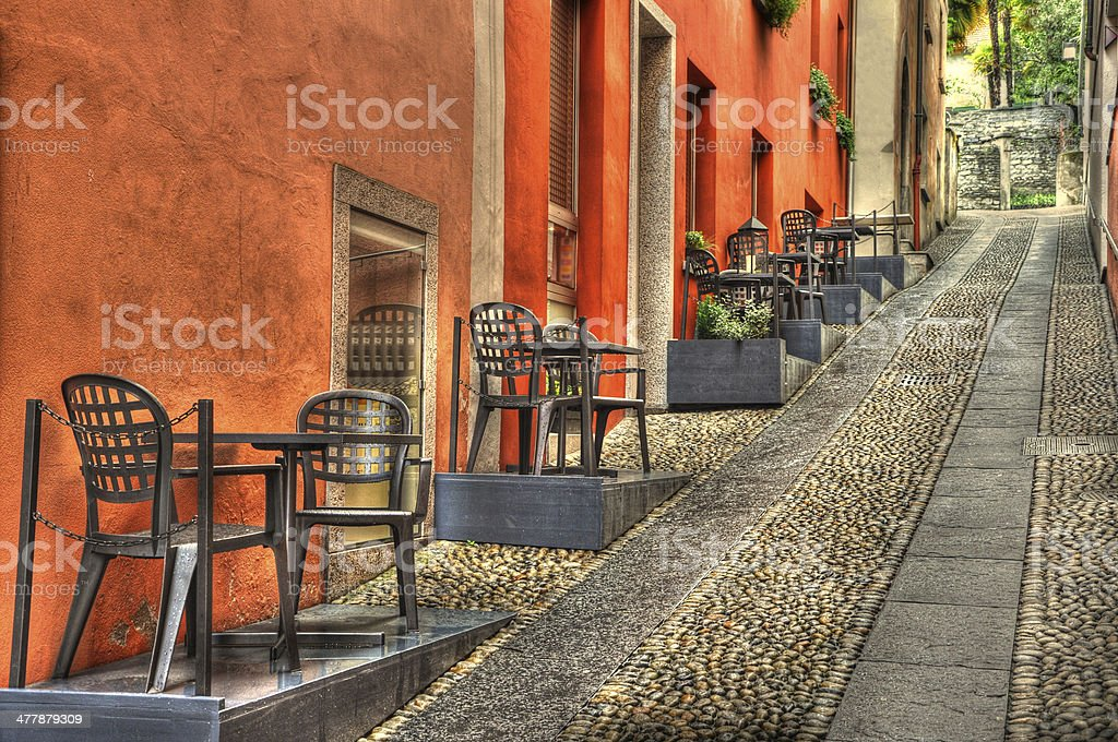 Stone alley with tables stock photo