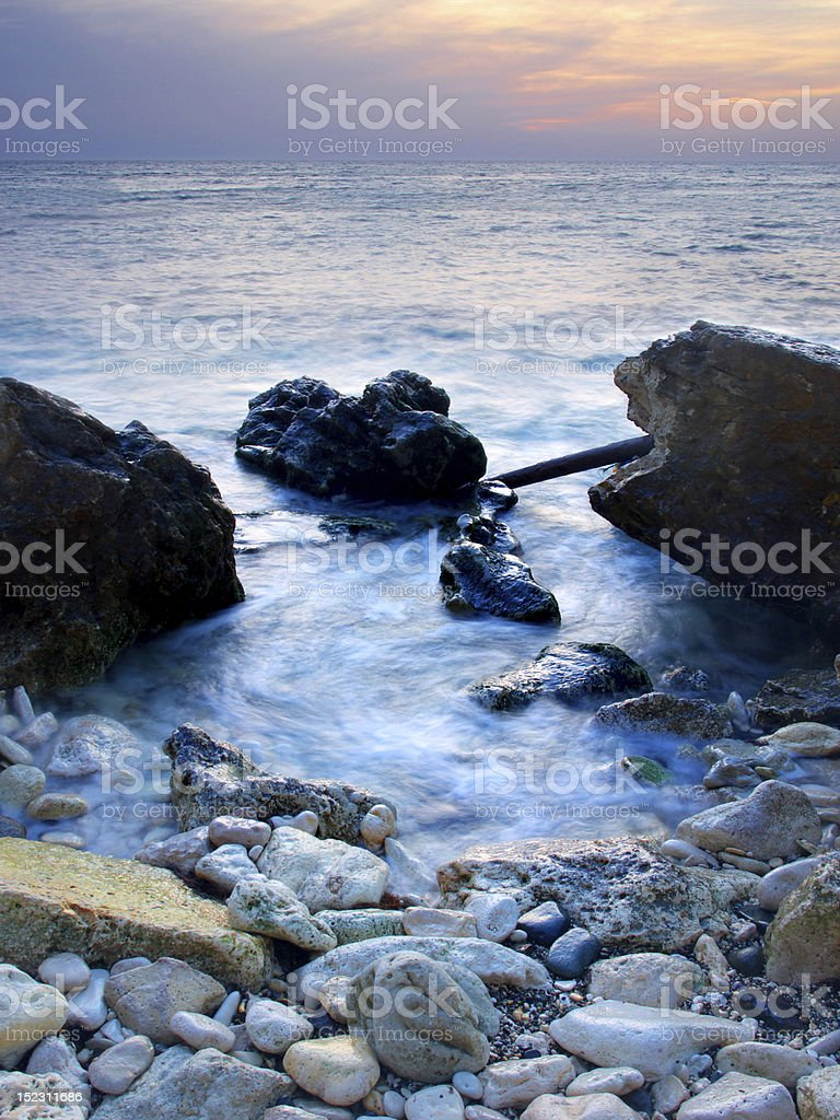 Stone and blue sea royalty-free stock photo