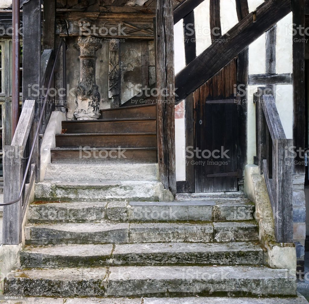 Stone and wood-carved staircase. stock photo