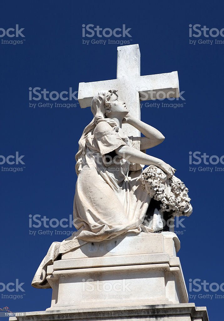 Stone Angel and Cross Memorial on Grave royalty-free stock photo