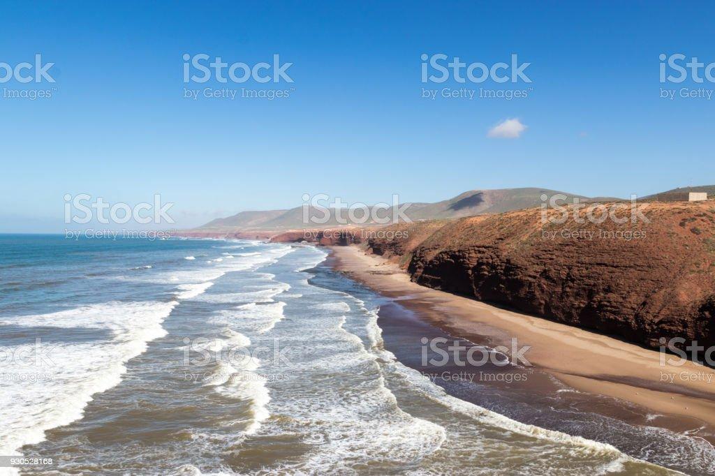 Stone arch and red cliffs near Sidi Ifni stock photo