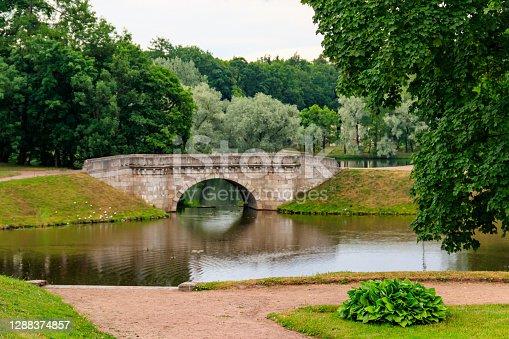 Stone arch bridge across a lake in Gatchina, Russia
