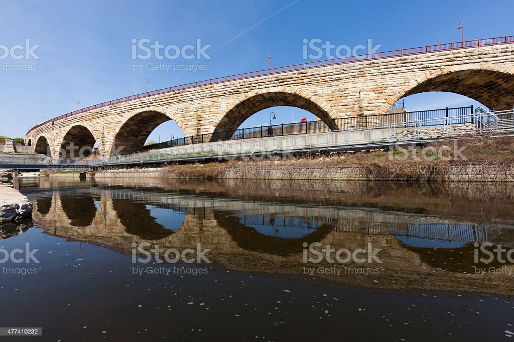 Stone arch bridge over Mississippi River stock photo