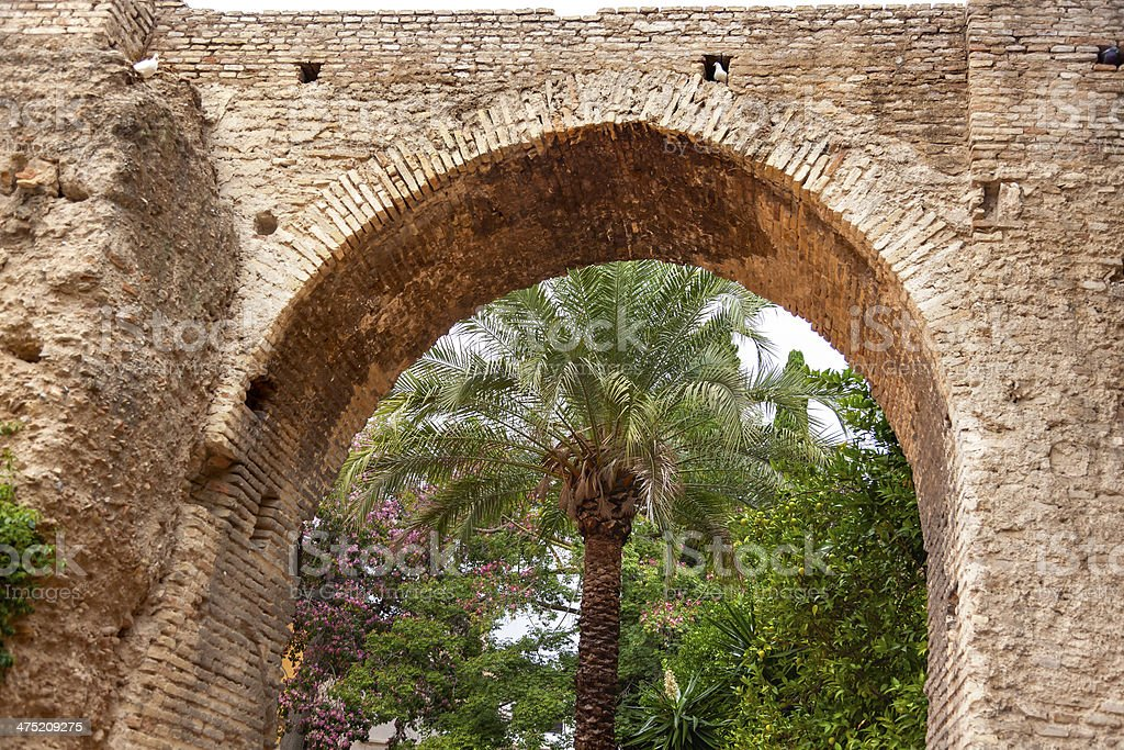 Stone Arch Garden Alcazar Royal Palace Seville Spain royalty-free stock photo