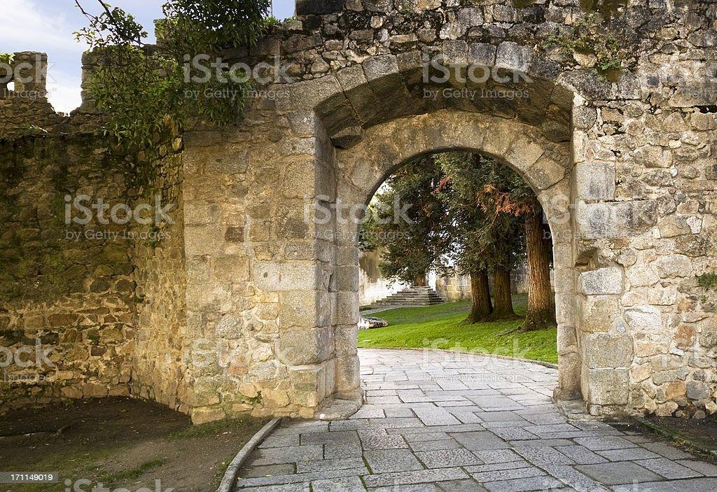 Stone arch in Evora stock photo