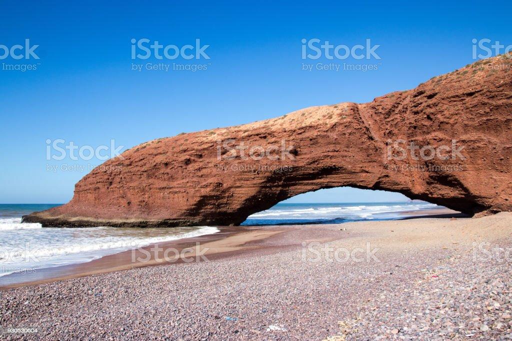 Stone arch in red cliffs near Legzira, Sidi Ifni, Morocco stock photo