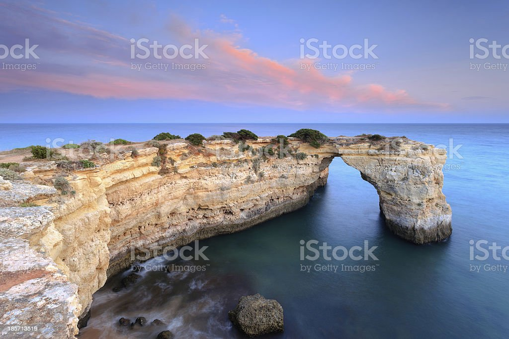Stone arch on the Algarve coast stock photo