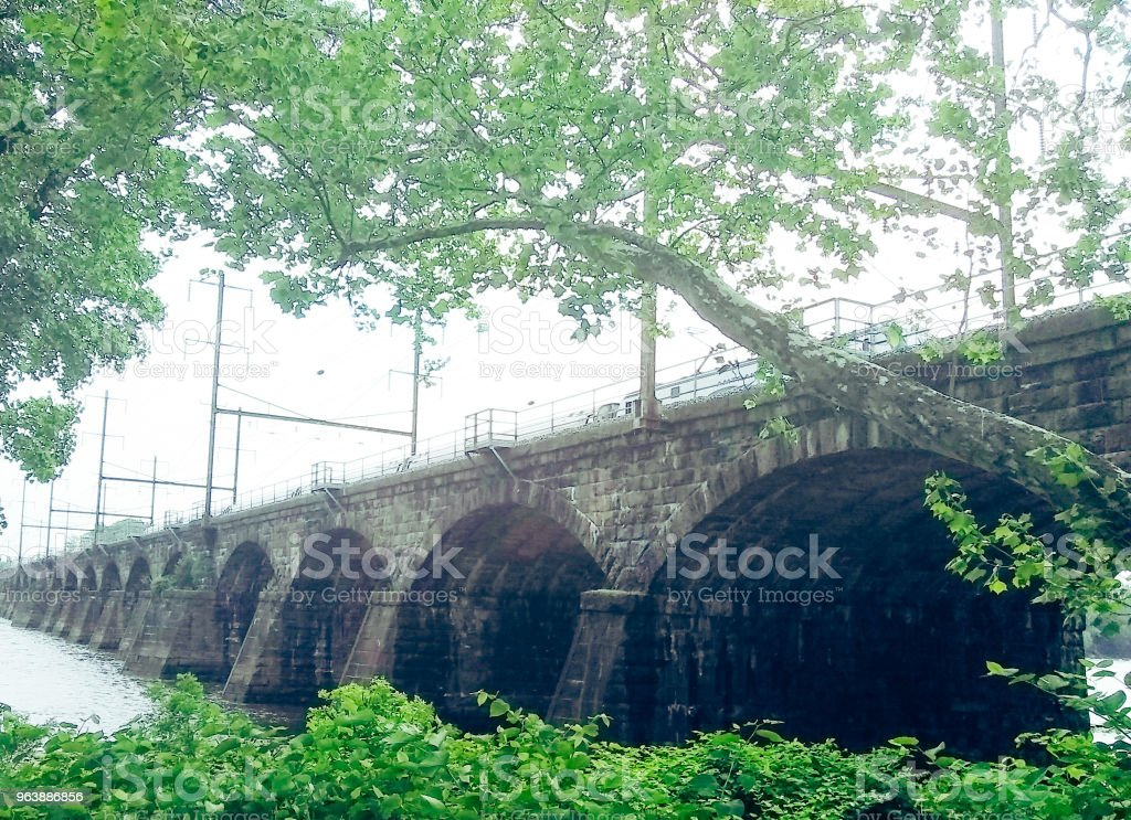1902 Stone Arched Railroad Bridge Crossing Delaware River from Pennsylvania To Trenton New Jersey stock photo