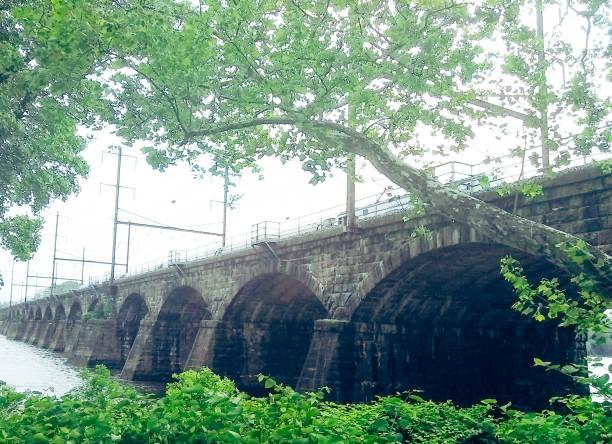 1902 Stone Arched Railroad Bridge Crossing Delaware River from Pennsylvania To Trenton New Jersey stock photo