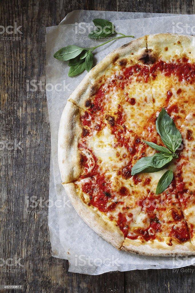 Stone baked marguerite pizza with basil garnish stock photo