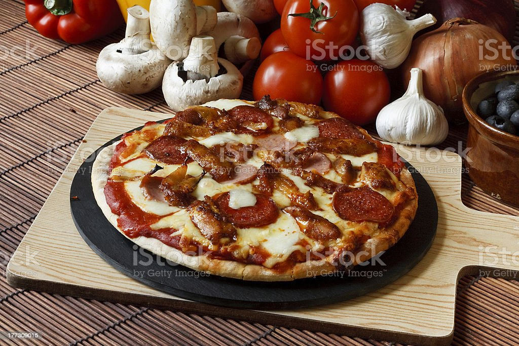 Stone baked Meat feast gourmet Pizza stock photo