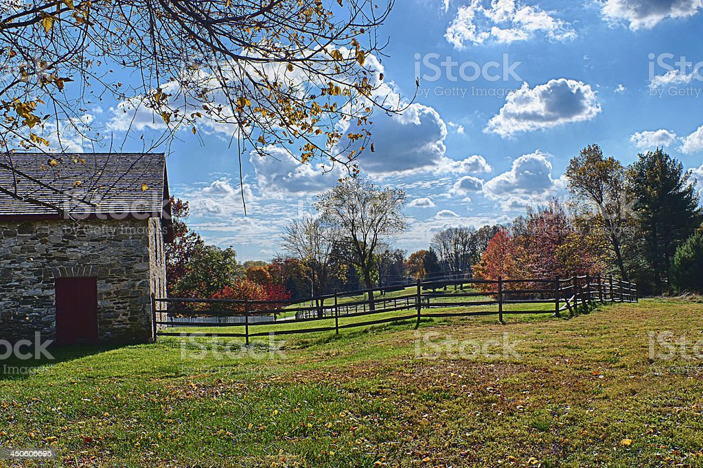 Stone Barn and Horse Corral in Autumn stock photo