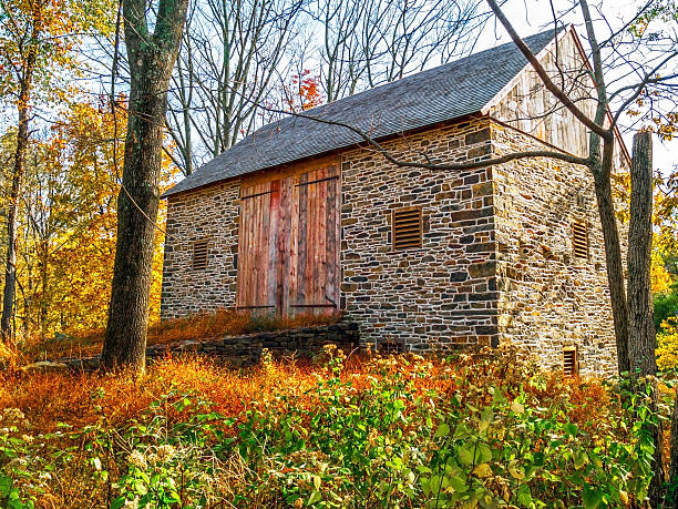 Stone Barn in Meadow stock photo