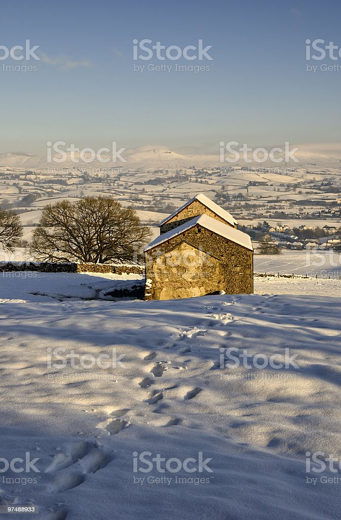 Stone barn in snowy landscape royalty-free stock photo