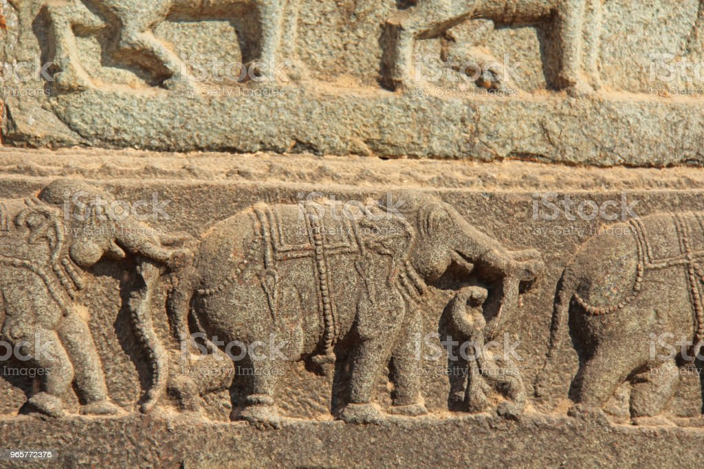Stone bas-reliefs on the walls in Temples Hampi. Carving stone ancient background. Carved figures made of stone. Unesco World Heritage Site. Karnataka, India. - Royalty-free Ancient Stock Photo