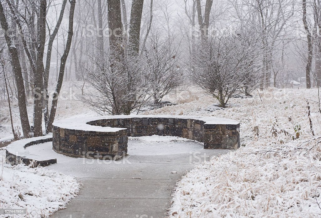 Stone bench in a park at winter stock photo