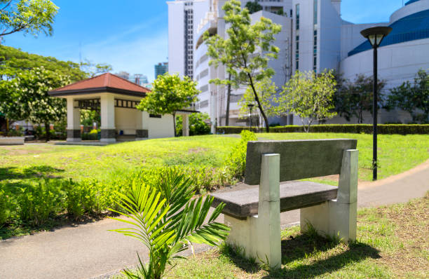 Stone bench in Park in the center of Makati, Philippines stock photo