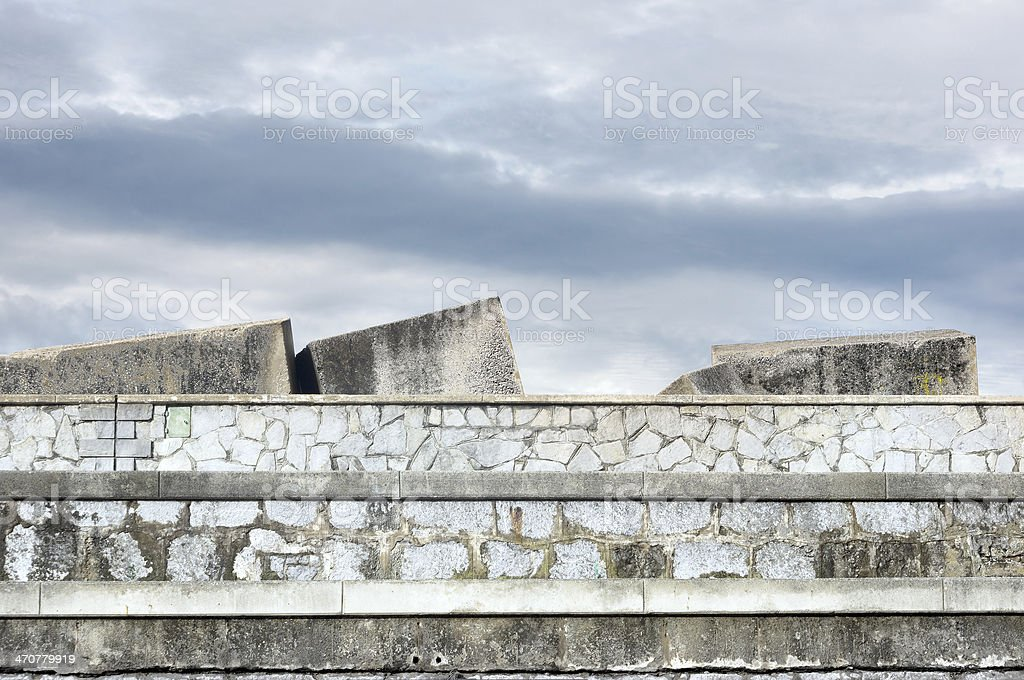 stone blocks in dock to protect against sea stock photo