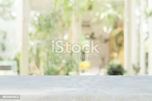 istock Stone board empty table in front of blurred background. Perspective brown stone over blur in coffee shop - can be used for display or montage mock up your products. vintage filtered image. 865965602