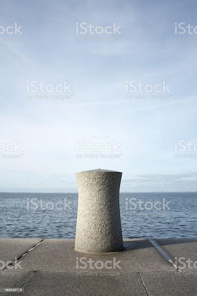 Stone bollard stock photo