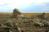Stone boulders at the site of an ancient sanctuary in the steppe. Tarkhatinsky megalithic complex, Altai, Siberia, Russia.