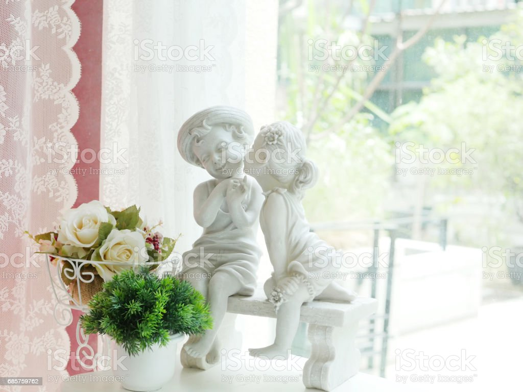 Stone Boy and Girl on table royalty-free stock photo