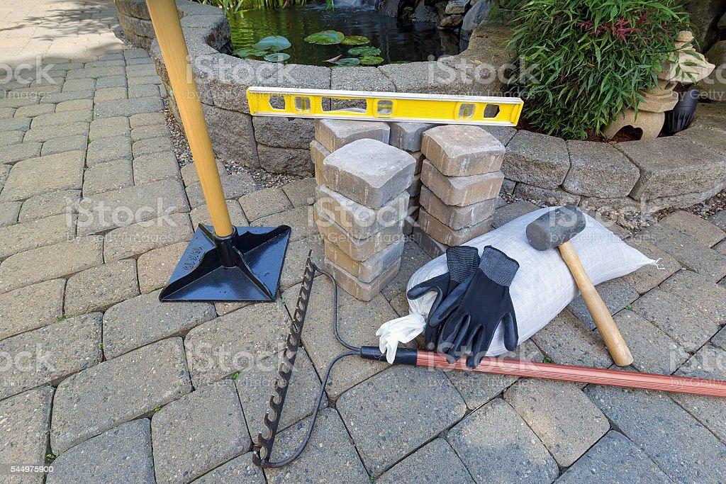 Stone Brick Pavers with Garden Tools stock photo