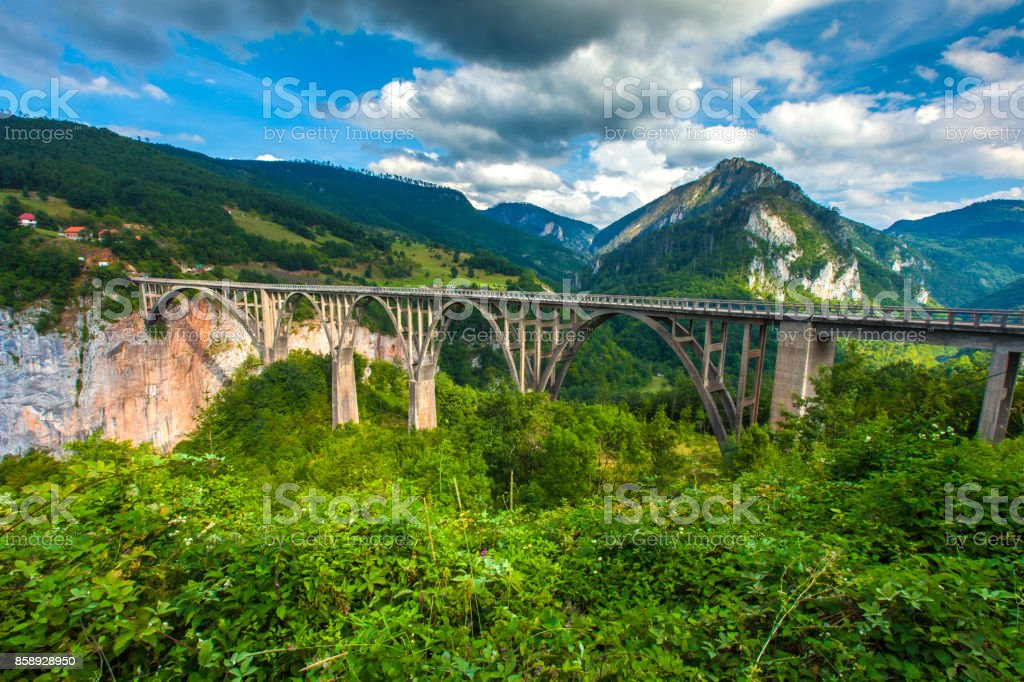 Stone bridge across the deep river canyon. stock photo