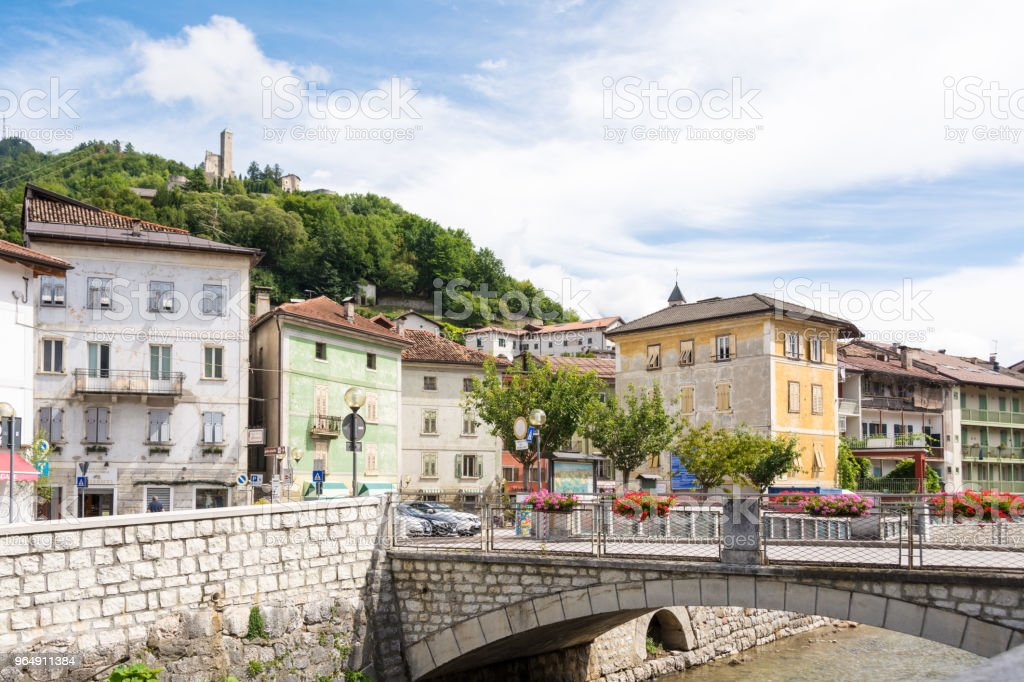 stone bridge decorated with flower vases in the Borgo Valsugana , a village in the Italian Alps royalty-free stock photo