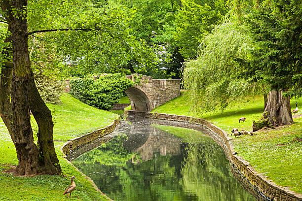Stone Bridge in Parc de la Boverie in Liege Stone Bridge in Parc de la Boverie in Liege, Wallonia, Belgium lulik stock pictures, royalty-free photos & images
