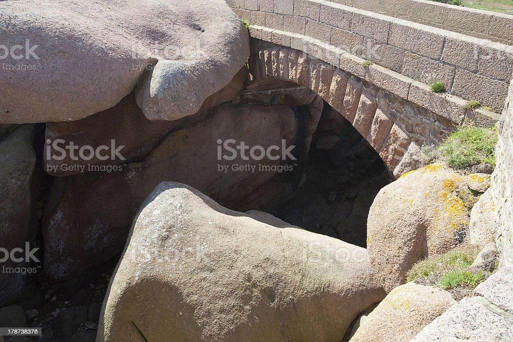 stone bridge made from rose granite rocks stock photo