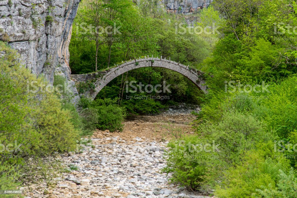 Stone bridge of Kontodimos bridge near Vitsa, Greece stock photo