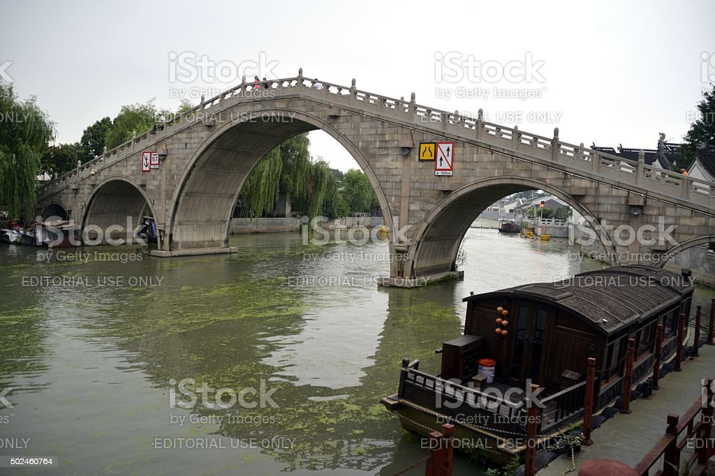 Stone bridge over Grand Canal in Suzhou old town, China stock photo