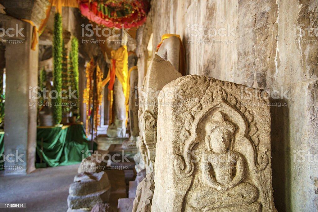 Stone buddha carvings, Angkor Wat royalty-free stock photo
