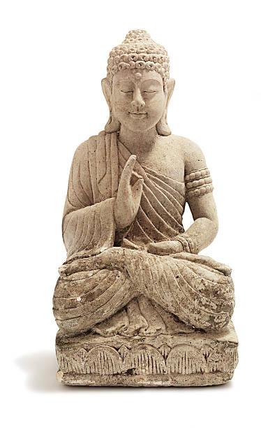 a stone buddha ornament on a white background - buddha stockfoto's en -beelden
