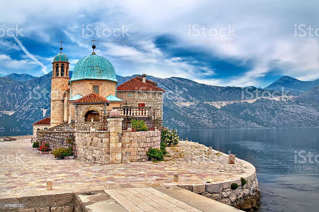 Stone building on an island on the lake in scenic Montenegro stock photo