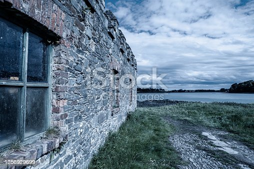 Abandoned stone built boat shed by the coastline.  County Down, Northern Ireland.