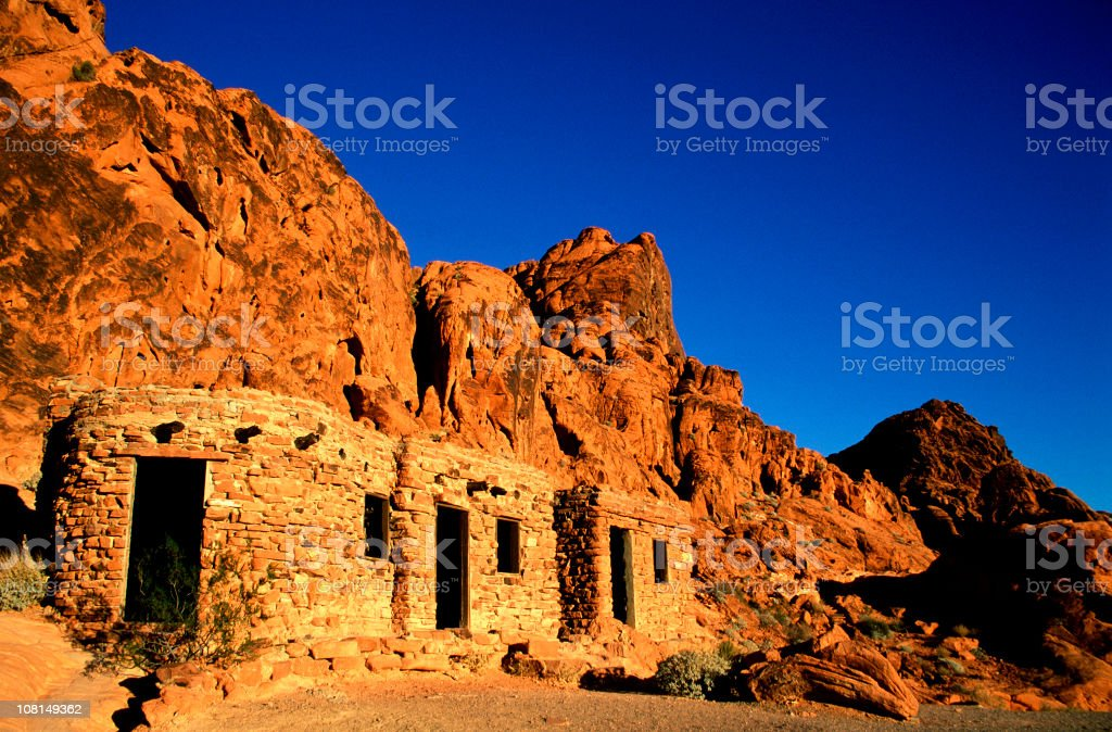 Stone Cabins Built on the Side of Desert Rock Cliffs royalty-free stock photo