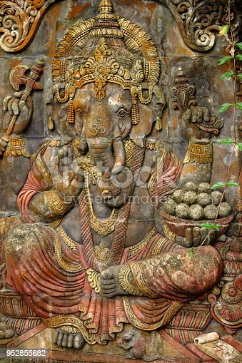 909806032istockphoto Stone carved elephant decoration in a Buddhist garden 952855682