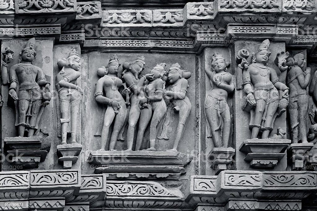 Stone carved erotic bas-relief in Hindu temple in Khajuraho, Ind stock photo