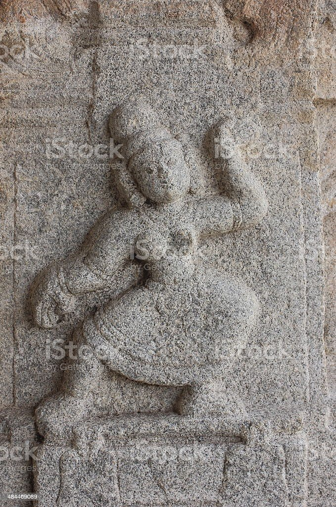 Stone carved sculpture of a woman royalty-free stock photo