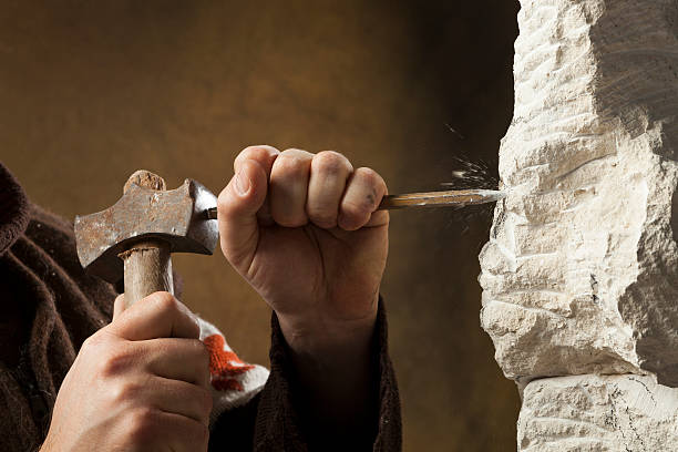 Stone carver's hands stock photo
