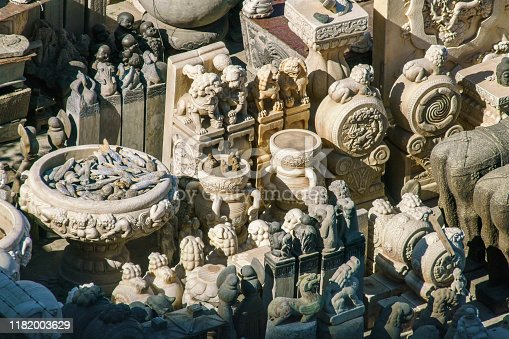 Stone carving will be waiting for sale at Panjiayuan Market in Beijing, China